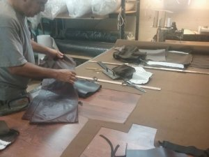 Leather chair - hand cutting the materials
