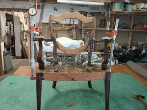 Re-upholstery wooden arm chair in process.
